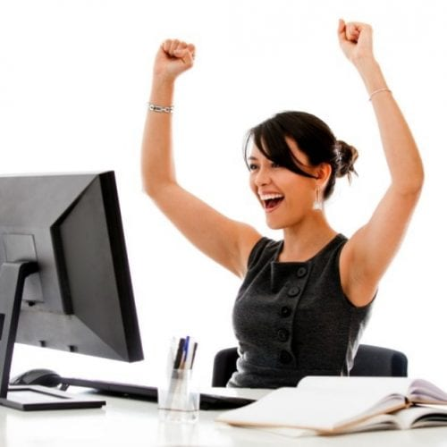 Allied Health Support Services Happy Lady in Front of Computer Image
